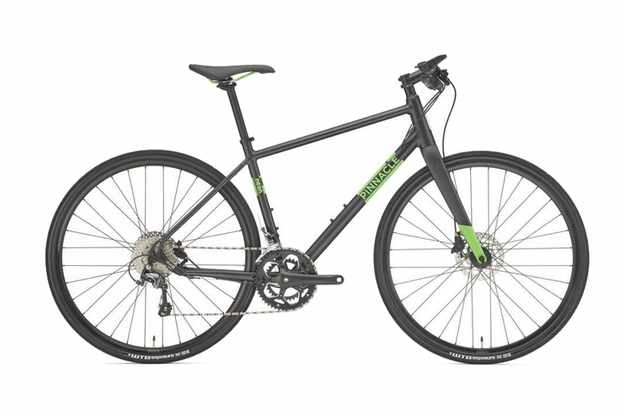 Photo of a black hybrid bike with the brand name Pinnacle written in green on the frame
