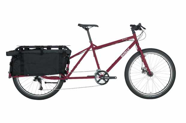 Dark red Surly Big Dummy bicycle with a load-carrying rack on the back, on a white background