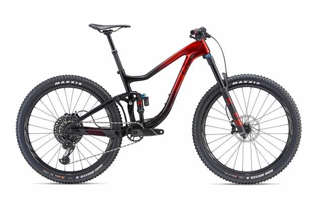 Red and black full suspension mountain bike on a white background