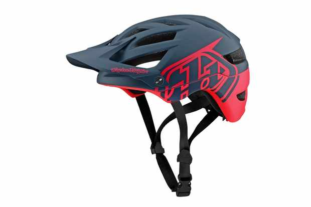 A red and black mountain bike helmet on a white background