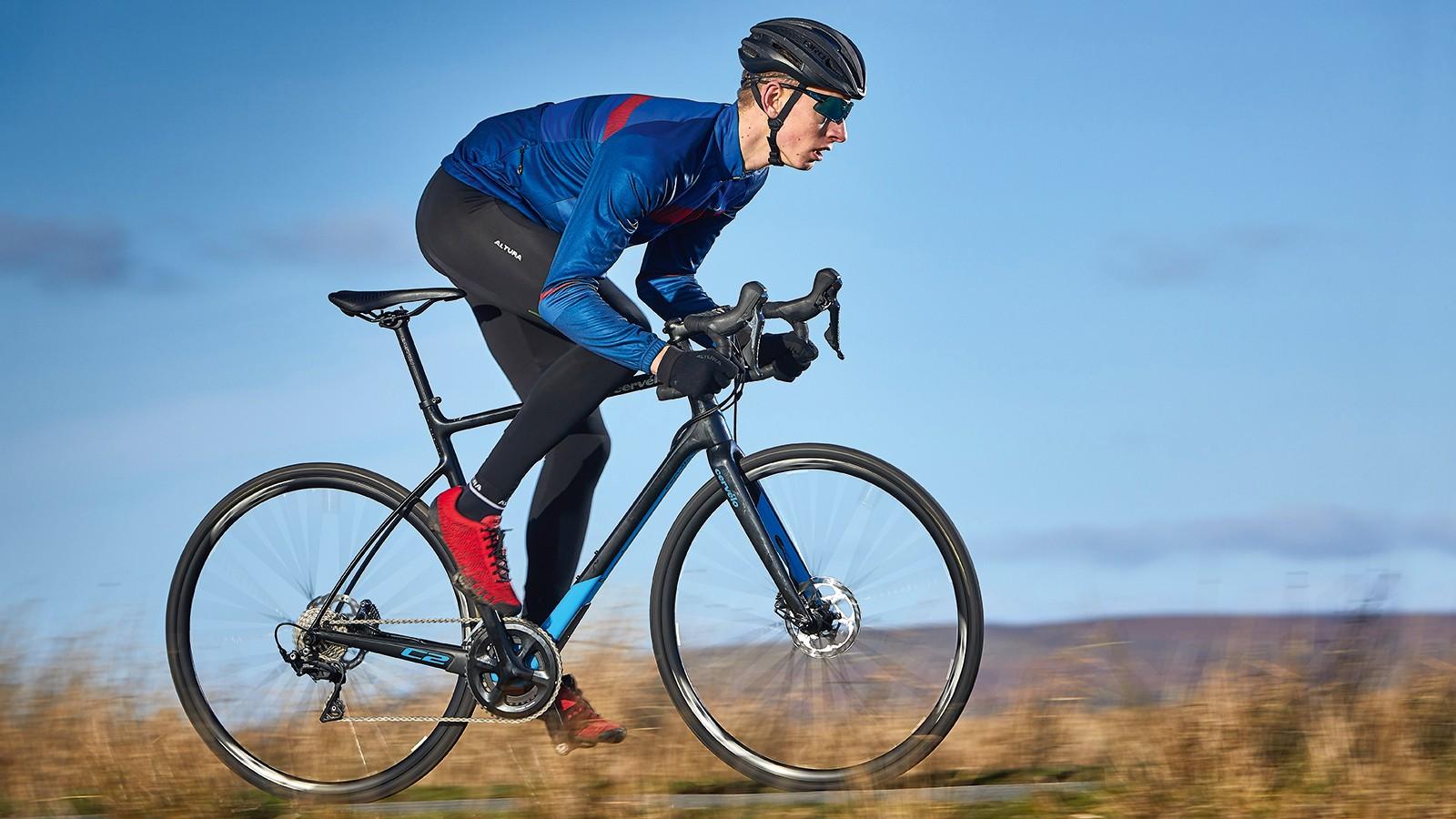 male cyclist riding black bike
