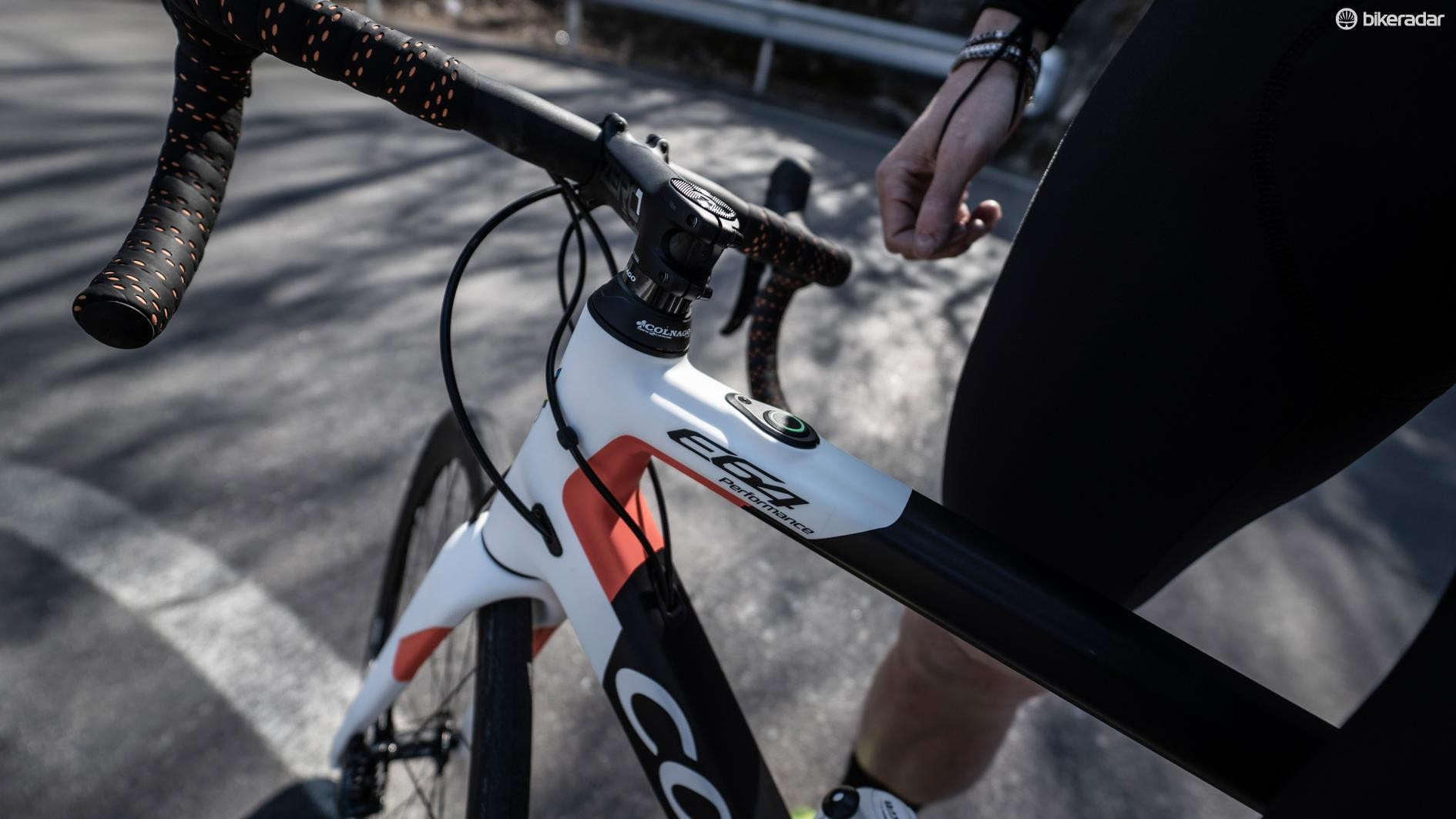 The e-bike system is controlled via a button behind the top tube