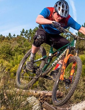 A rider doing a drop-off on the Commencal meta tr 29