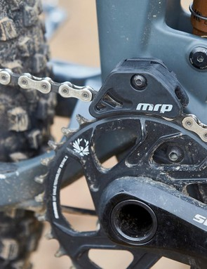 There's a chain guide there to keep the drivetrain running smooth in the choppiest of terrain
