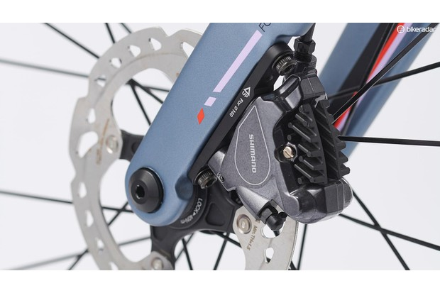 Close-up detail of hydraulic disc brakes at the wheel hubs