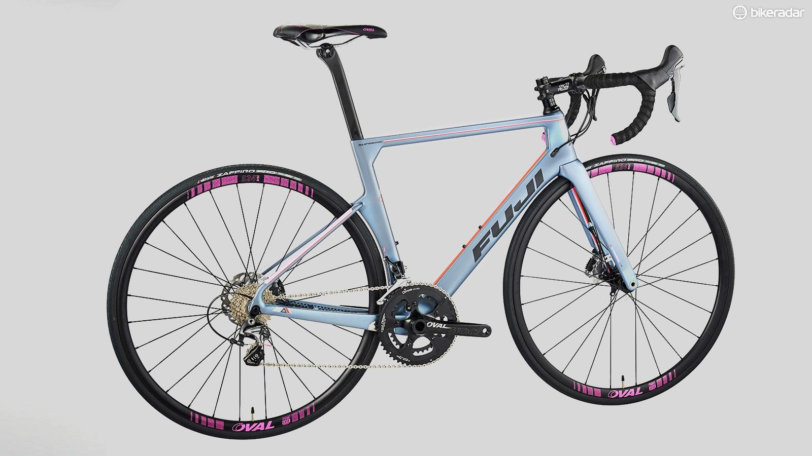 Side-on photo of the Fuji Supreme 2.3 women's road bike in a grey frame with pink details