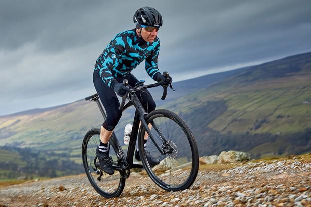 Male cyclist riding black bike on Mendips