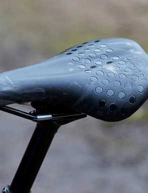 The Juliana-branded women's mountain bike saddle which is black with a dotted pattern