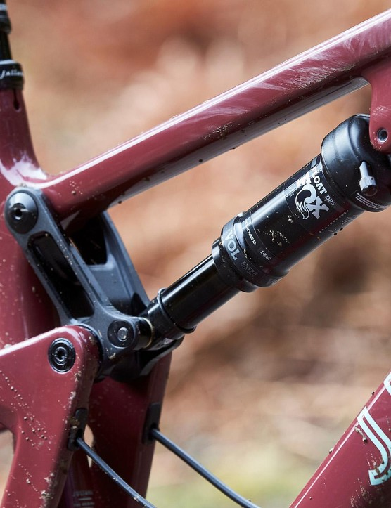 Detail photograph showing the rear suspension system and frame of the Juliana Furtado mountain bike
