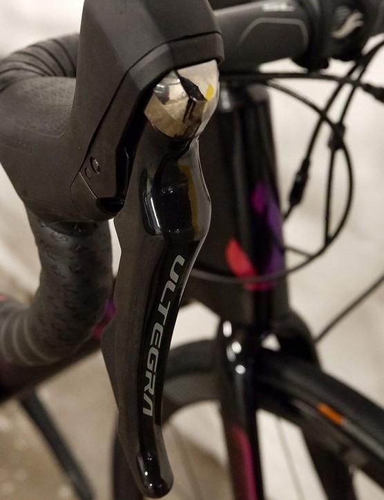 handlebars and shifters on women's road bike