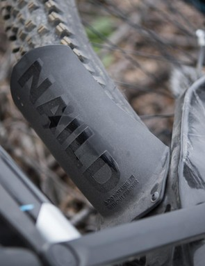 The mudguard keeps debris from damaging the slider and its use is a condition of the bike's warranty being upheld by Marin