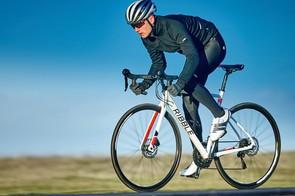 male cyclist riding white bike on mendips