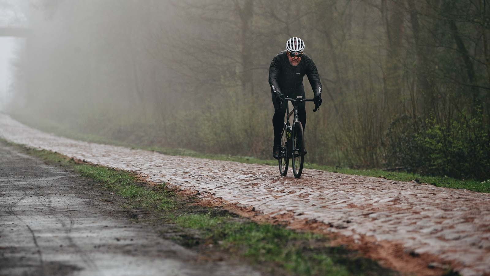 The Specialized Roubaix being ridden on coibbles by tech editor Warren Rossiter