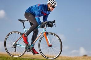 male cyclist riding blue bike
