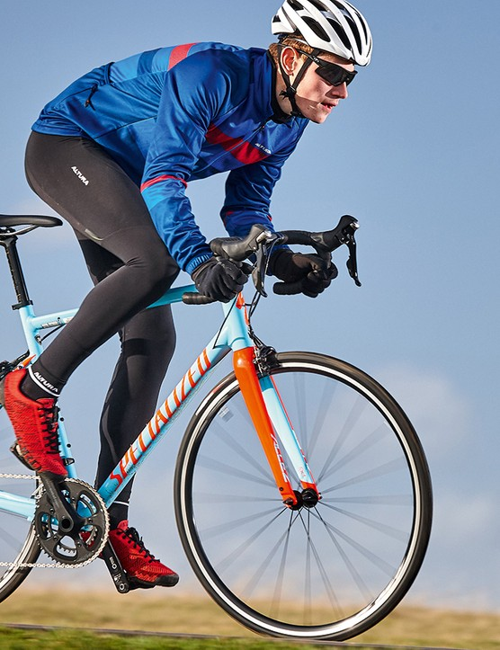 male cyclist riding blue bike