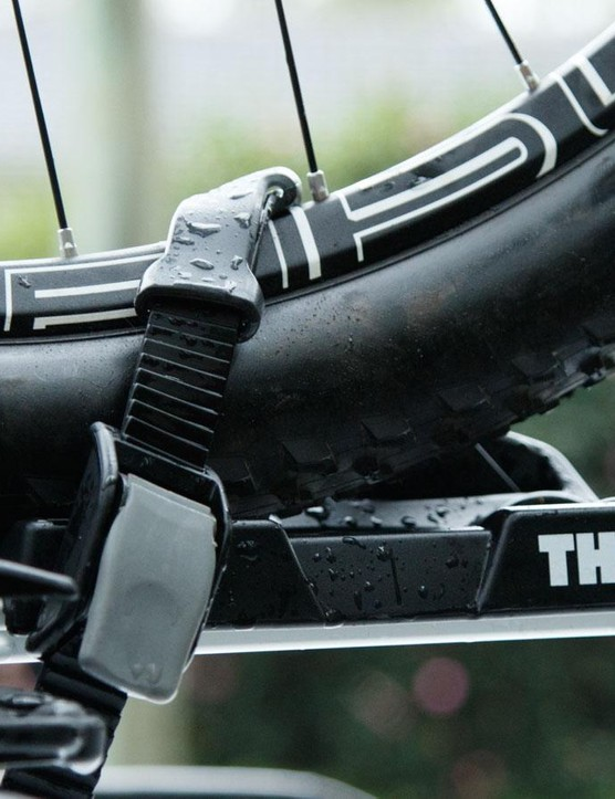 Another view of those diagonal wheel straps. Note the rubber piece used to protect from rim stratching – just don't make our mistake of leaving the strap loose, or it flies away
