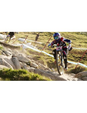 Downhill mountain bikes have 200mm of travel front and rear, which allows racers like Tracey Hannah to ride through some incredibly steep and technical terrain