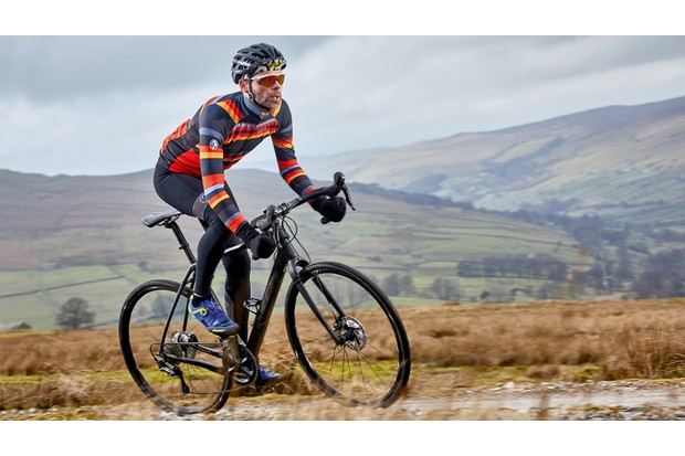 Cyclist riding black bike in countryside