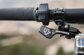 The Shimano E7000 mode selector is a subtle pair of buttons next to the grips that toggles through the four modes. Boost, Eco, Trail and Walk (Notice YT uses the RacFace dropper lever)