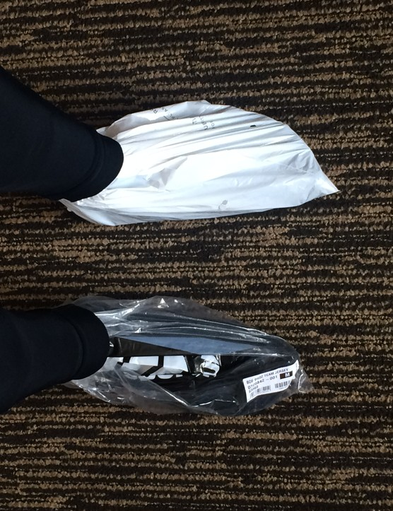 Cyclists feet in plastic bags
