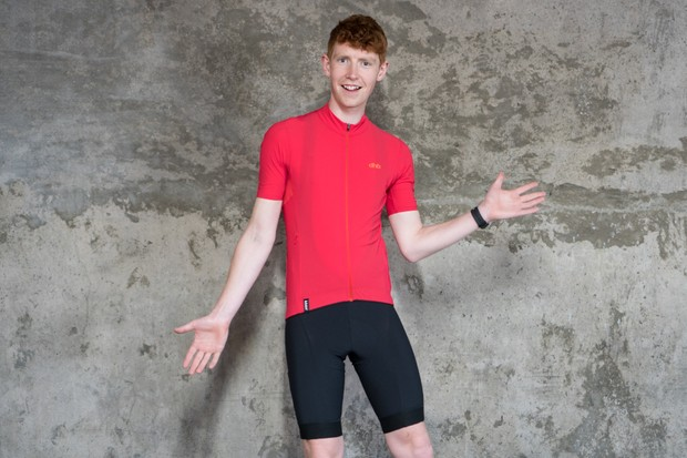 Model wearing cycling shorts and jersey