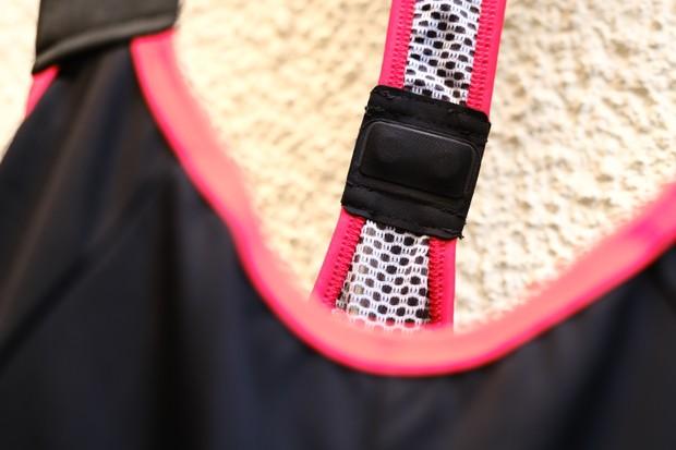 Detail shot of black bib shorts showing a clasp