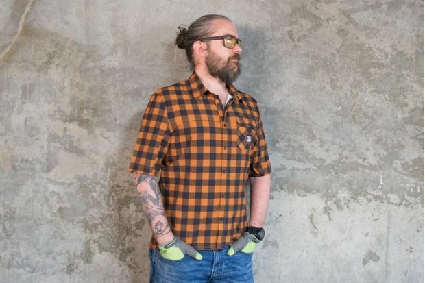 Man wearing orange and brown check Morvelo Overland shirt