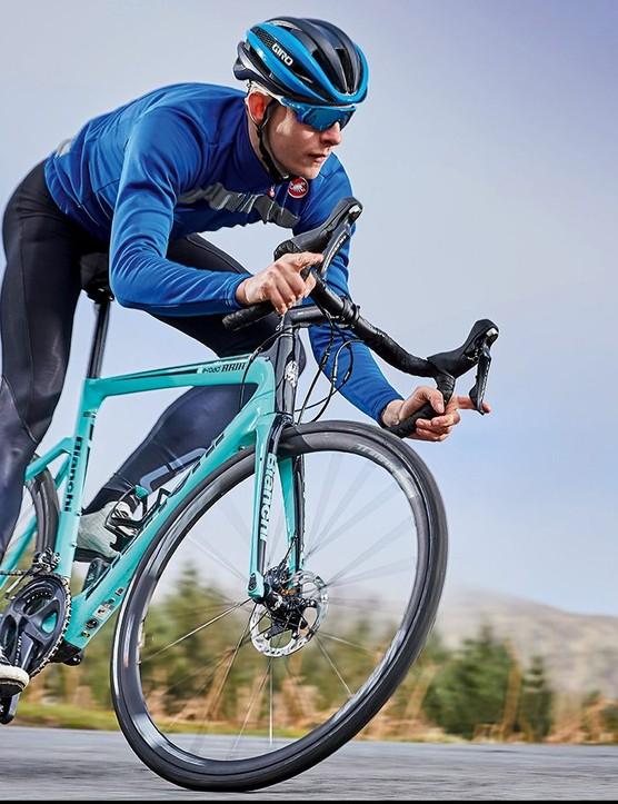 male cyclist riding teal road e-bike bike