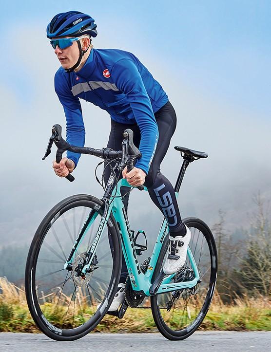 male cyclist riding teal road e-bike bike in countryside