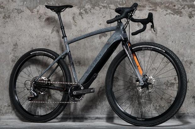 grey gravel road bike against wall