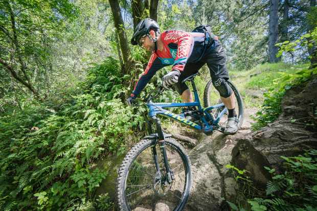 Enduro Collection on mountain bike rider descending rocky singletrack