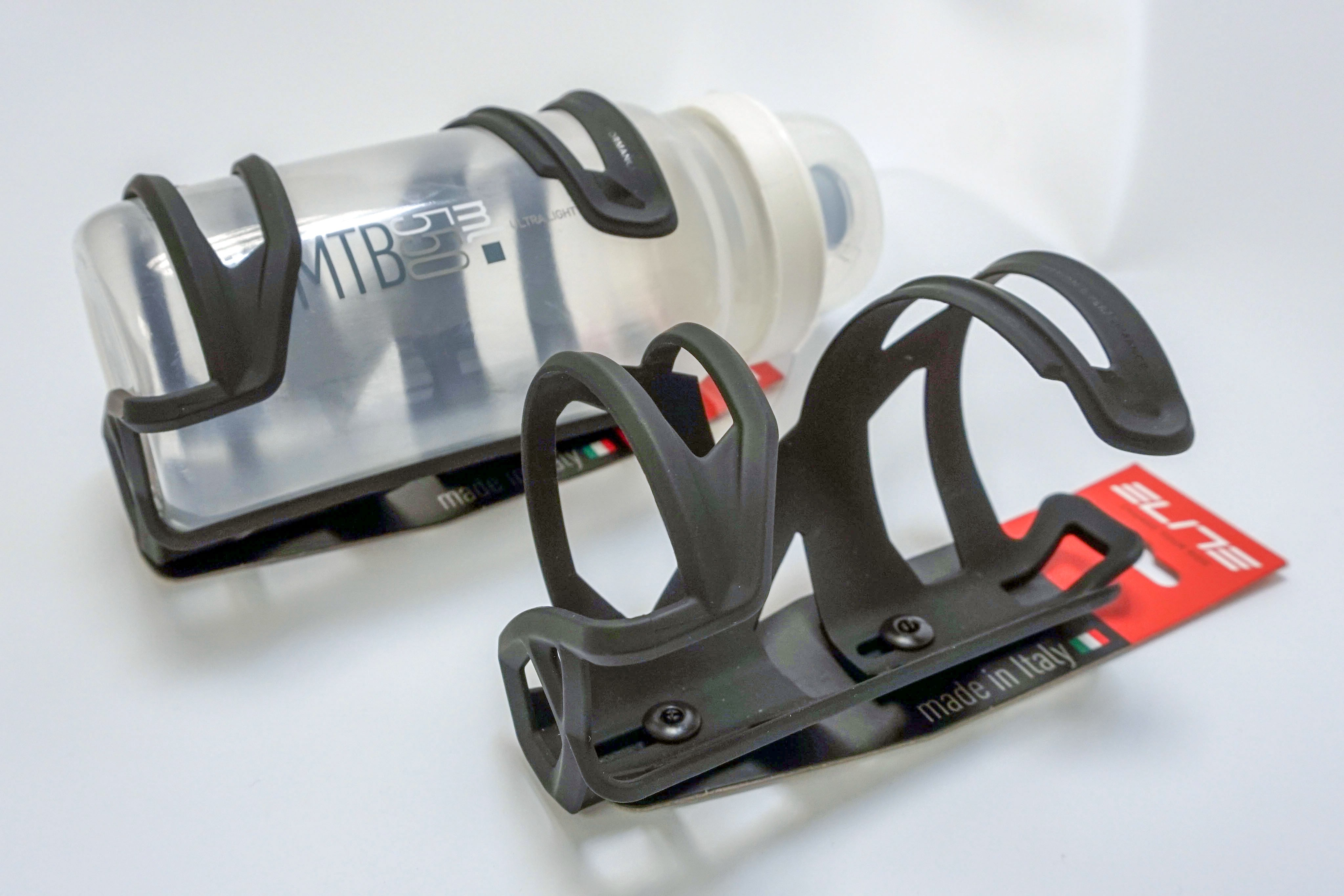 Two Elite Prism side-loading bottle cages, one with a bottle in place