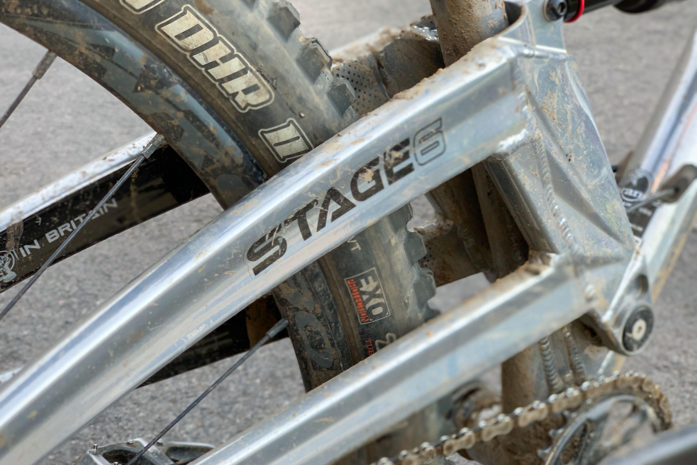 Orange Stage 6 mountain bike logo on bike's swing arm