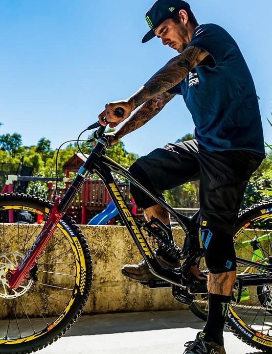 Sam Hill sat on the new Dissent downhill bike