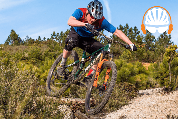 Rider riding a mountain bike off a drop with the BikeRadar Podcast logo in the top right corner