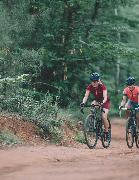 Pair of gravel riders in forest Scott Sports