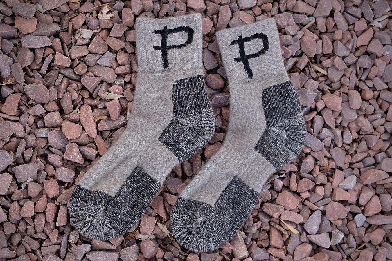 woollen cycling socks on stones