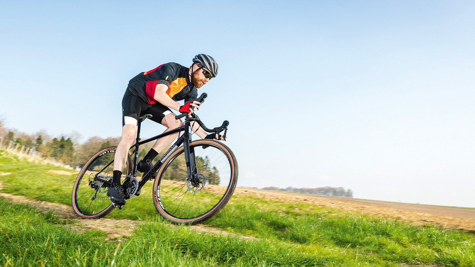 Male cyclist riding road bike in countryside