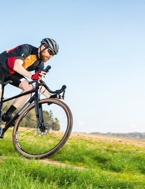 male cyclist riding brown bronze road bike in countryside