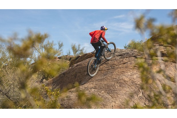 Aaron Chase rides Pivot electric mountain bike up a steep hill
