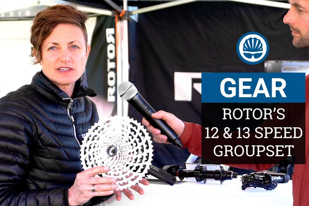 Lori Bennett holds 13-speed Rotor cassette at Sea Otter bike show 2019