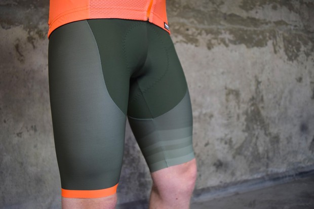 Santini green shorts with ornage highlight on seam worn by a man