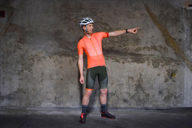 Santini orange-coloured cycling jersey and green shorts worn by a man