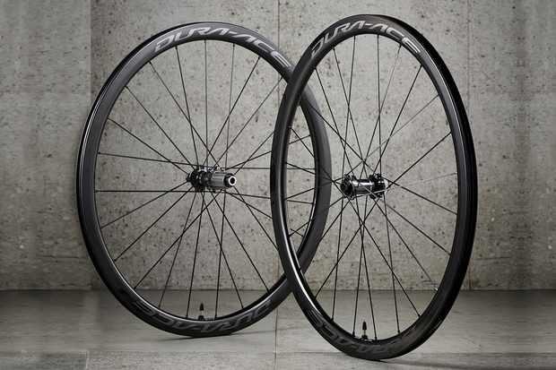 Road bike wheelset againt concrete wall