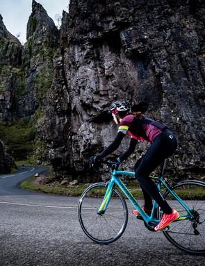 female cyclist riding blue road bike chedder gorge