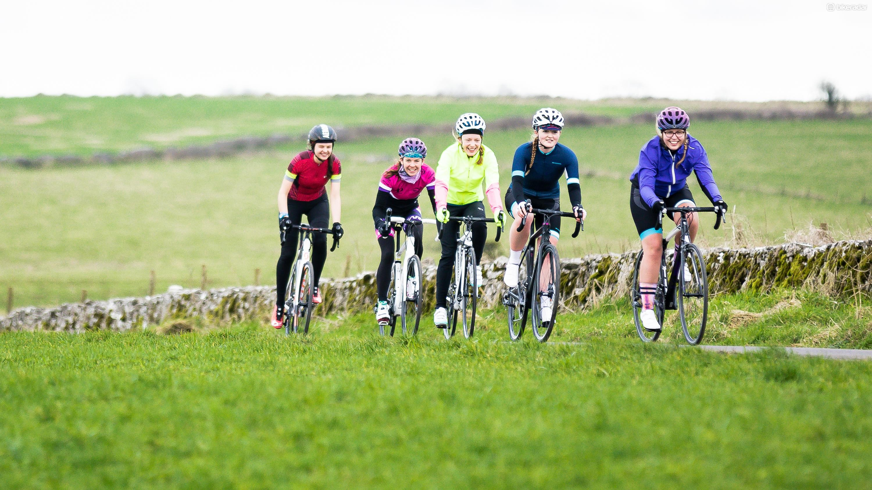 woman female cyclist riding road bikes mendips