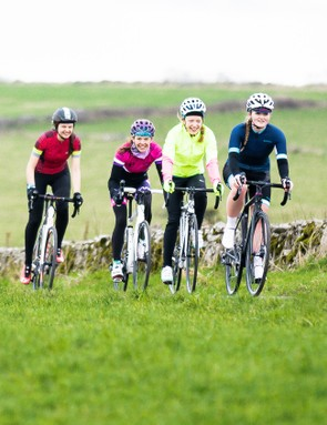 woman female cyclist riding road bikes mendips