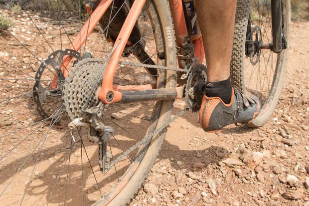 male cyclist riding bike on dirt track