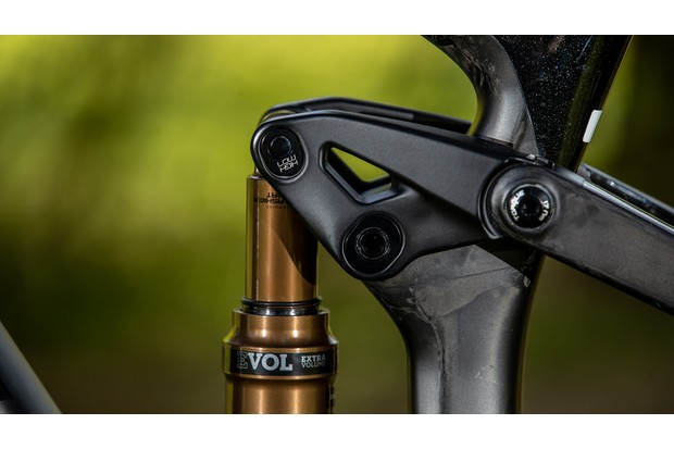 Mountain bike geometry adjustment and rear shock