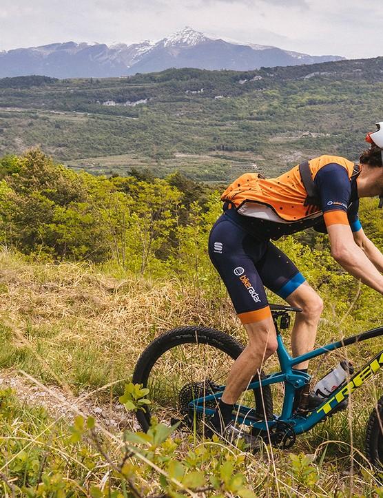 Cyclist riding blue full suspension mountain bike